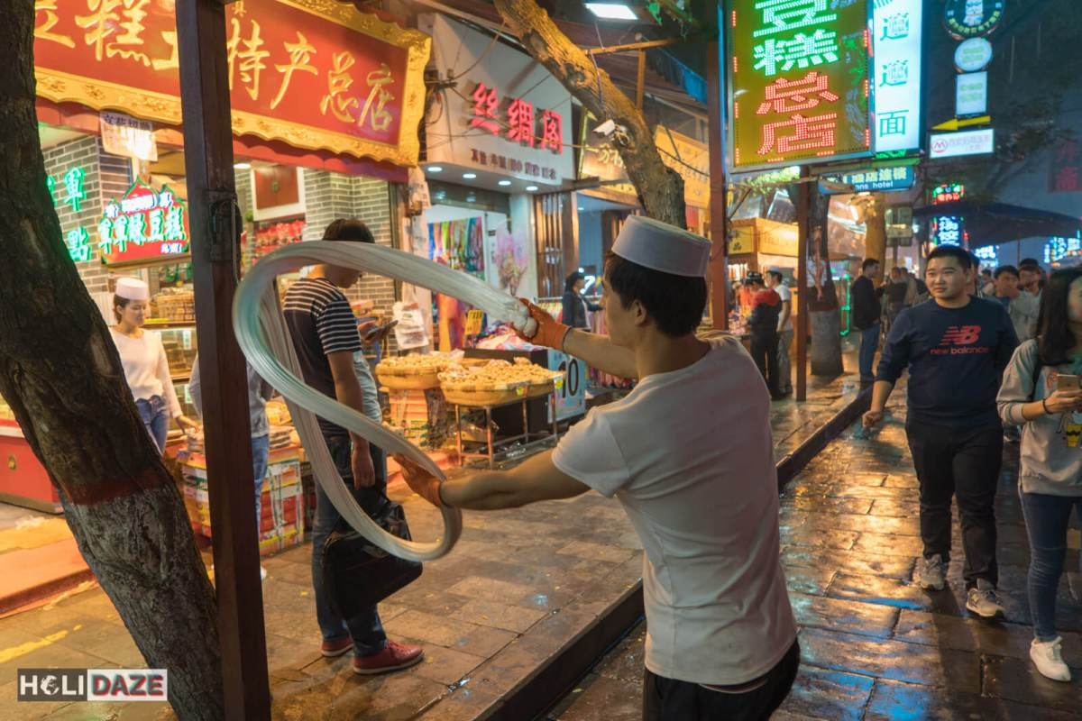 There are tons of guys in the street hand-kneading dough in a most elaborate way, using a hook on the way to hold the other end