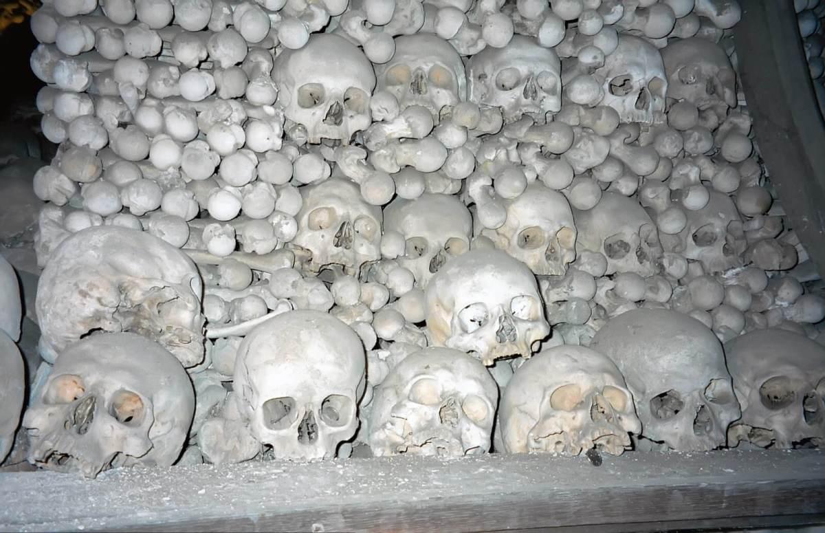 Pile of skulls and femurs at Sedlec Ossuary in the Czech Republic