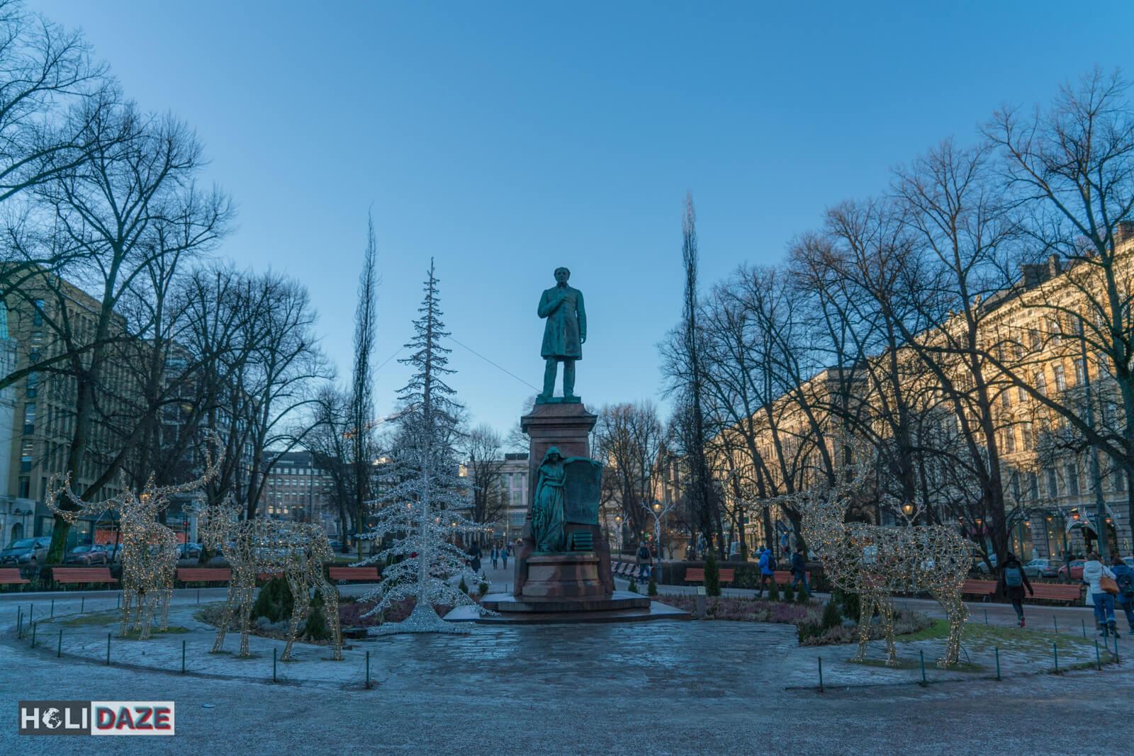 Statue at the center of Esplanadi, the park promenade in downtown Helsinki near Central Market
