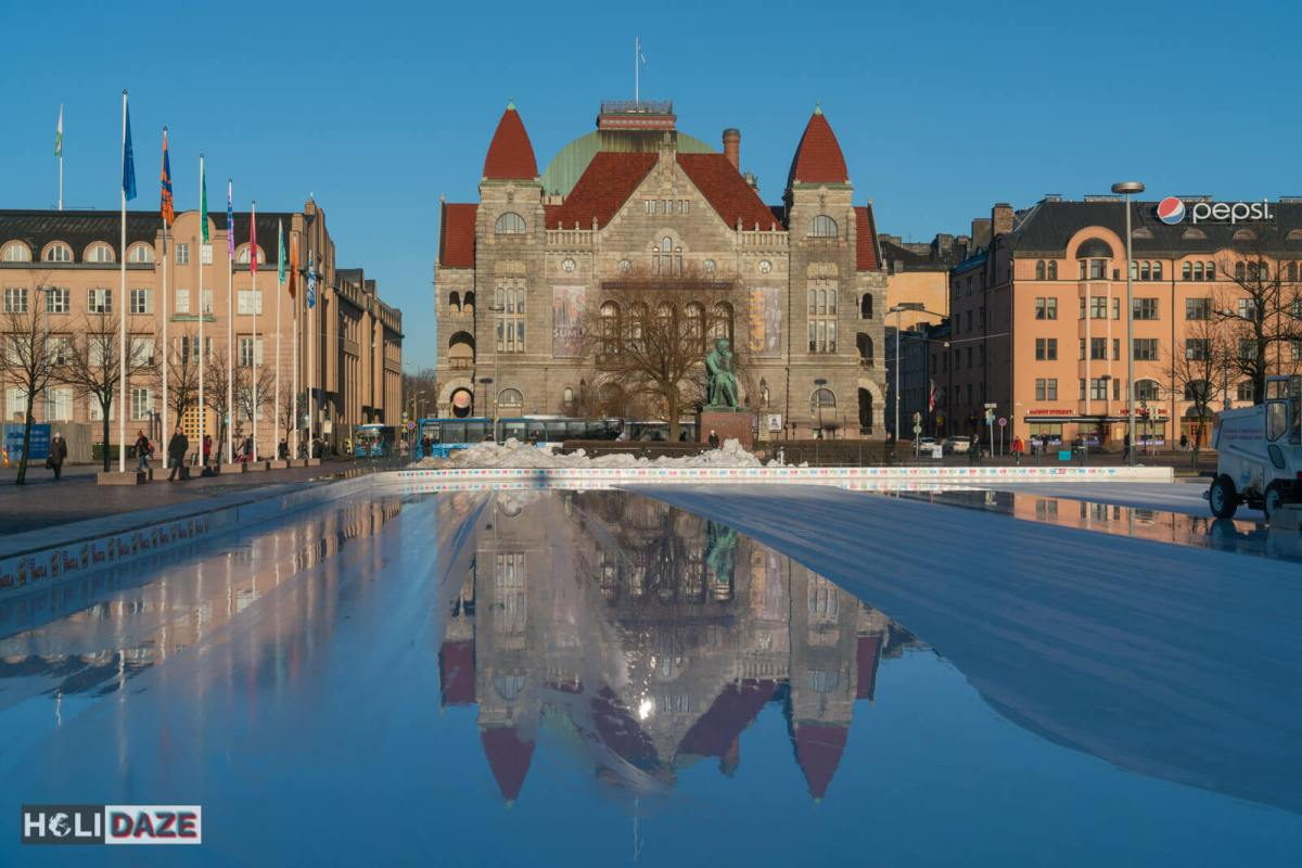 The ice-skating rink in front of the Finnish National Theatre in Helsinki city center makes a great mirror for a few seconds after the Zamboni smooths the surface