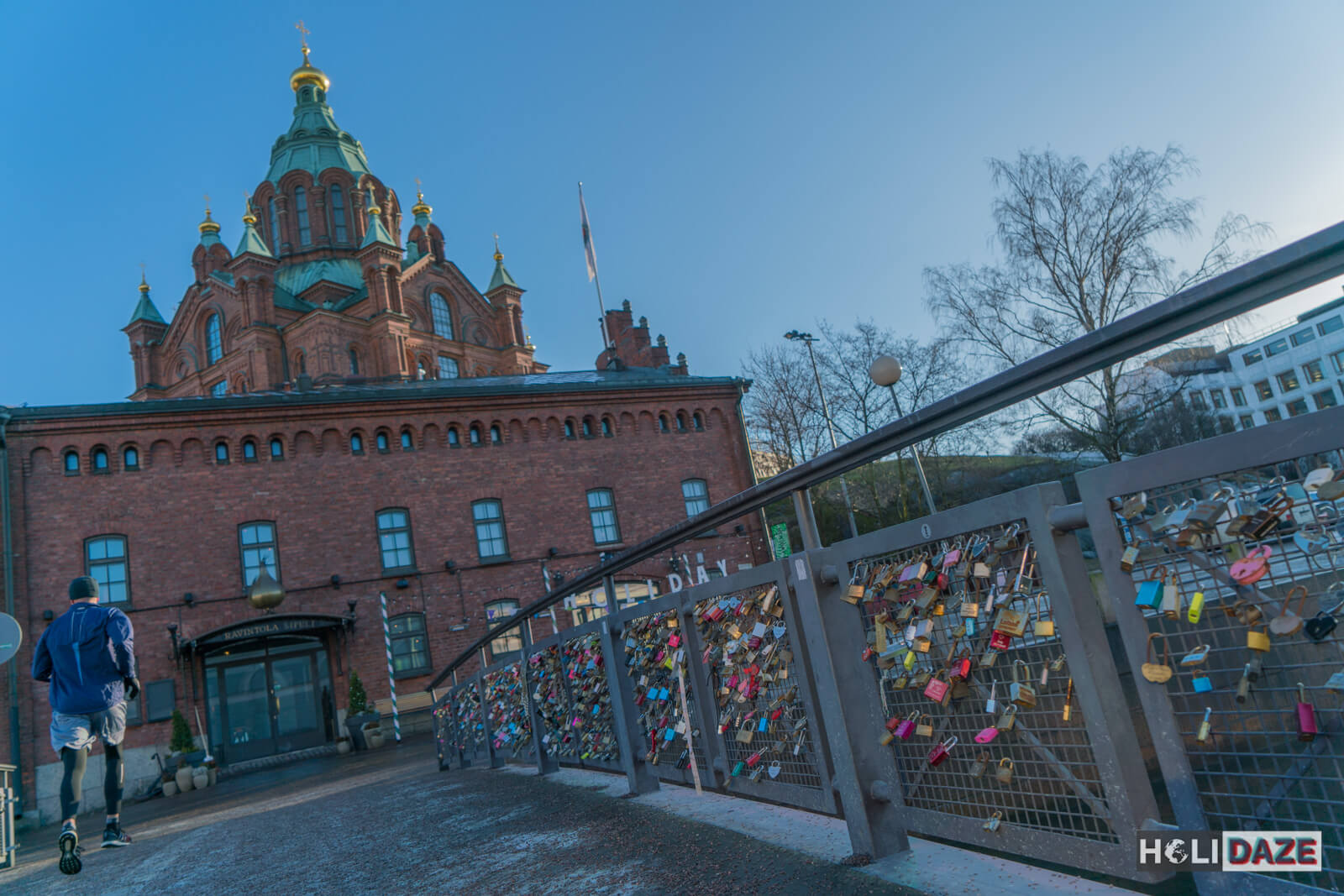 Jogger crossing the Helsinki love lock bridge