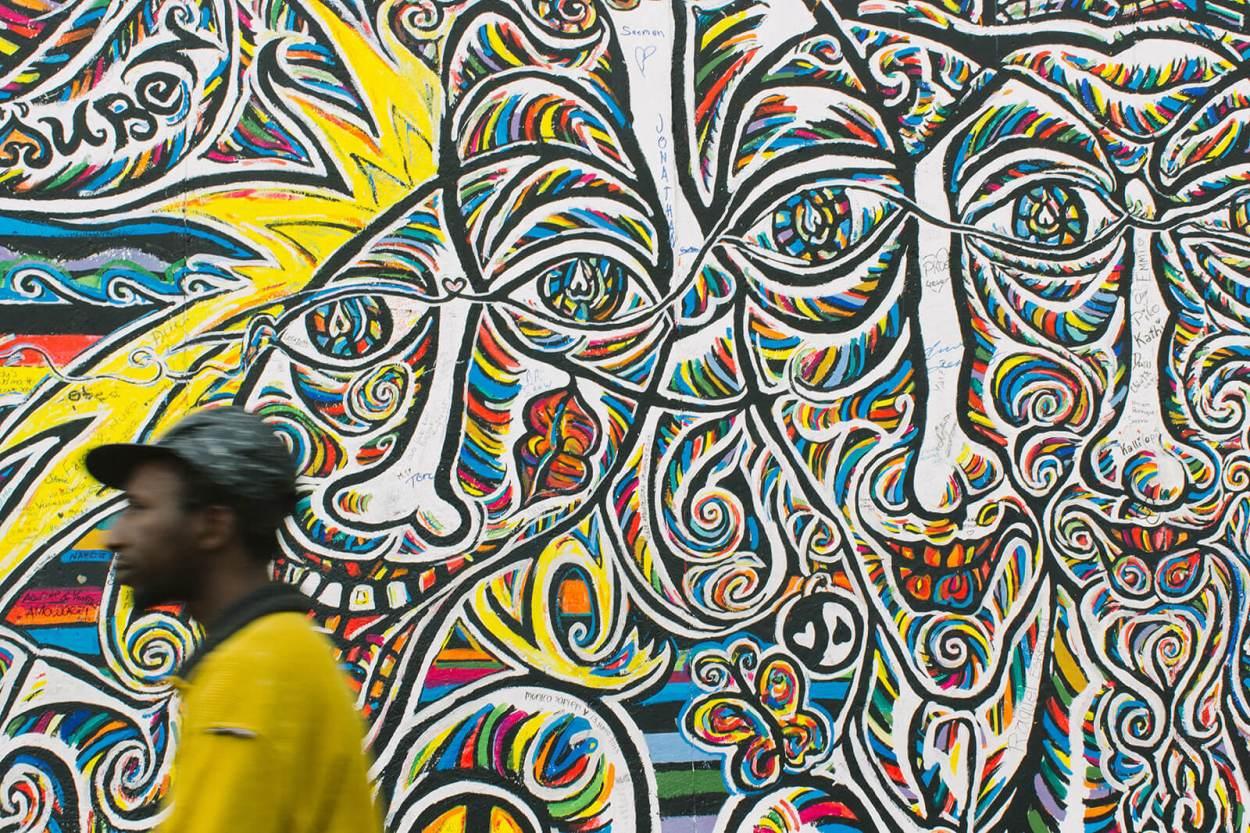 Street art faces in the East Side Gallery, Berlin, Germany