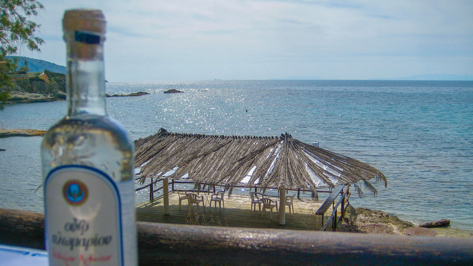 Drinking Ouzo and enjoying the view of the Greece coastline