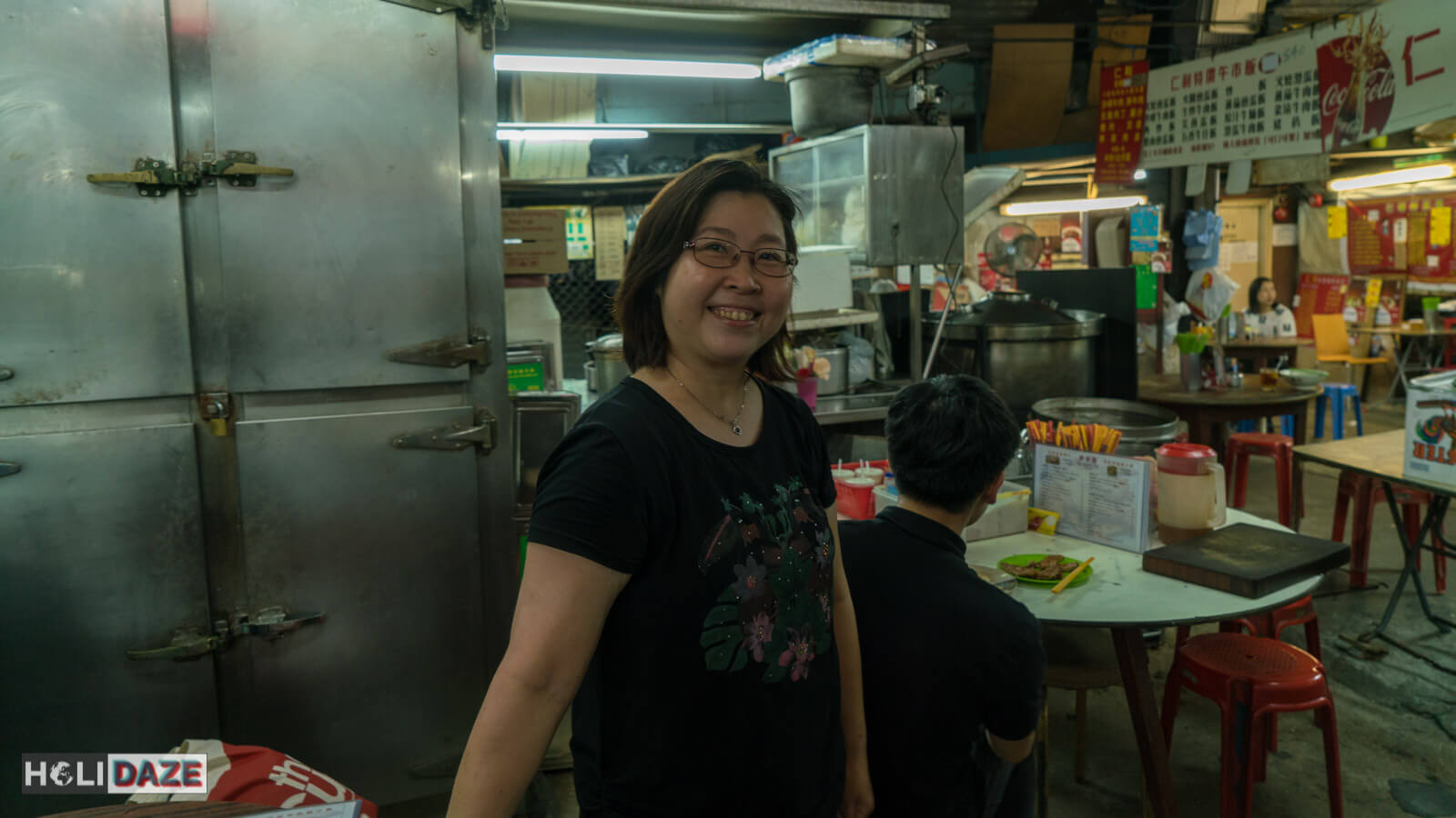 When visiting the Haiphong Road Temporary Market, look for this lady -- she speaks English and will ensure that you leave with a full belly -- and full wallet