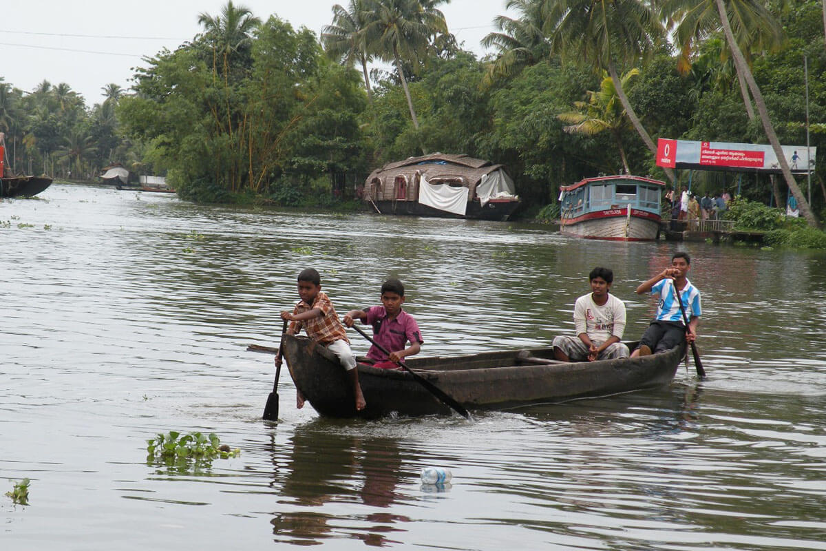Children on a boat in the Kerala backwaters of India
