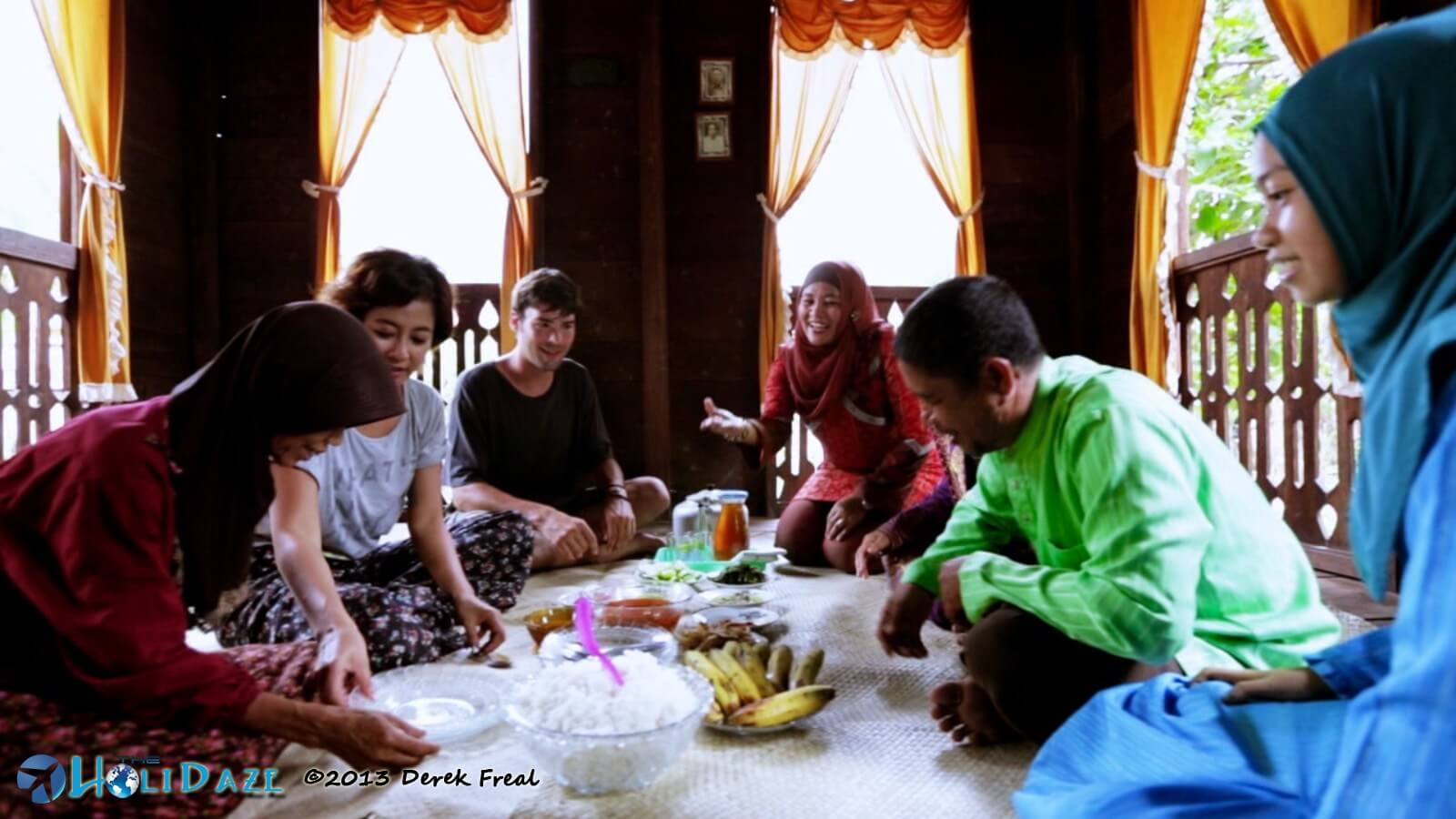 Derek Freal and Riyanni Djangkaru cook dinner with locals in Sumatra