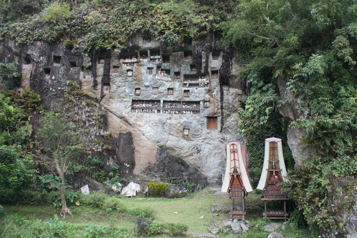 In Tana Toraja the deceased are buried on cliffs following elaborate ceremonies and rituals -- witnessing one has become a popular offbeat Indonesia activities for tourists