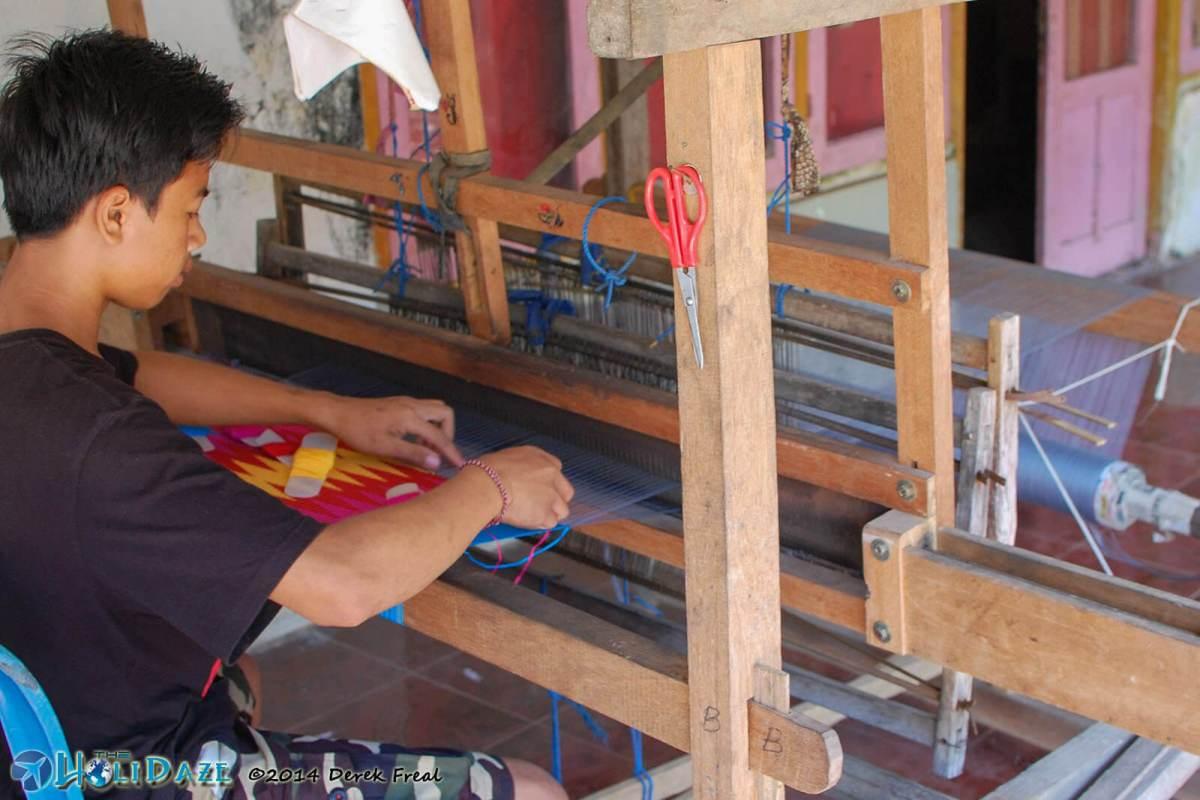 Local Tanglad kid making his own tenun