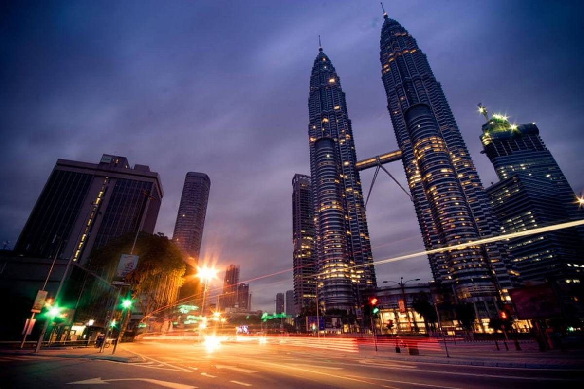 The Petronas Twin Towers are one of the top things to do in Kuala Lumpur, Malaysia and a popular meeting place for tourists and locals alike