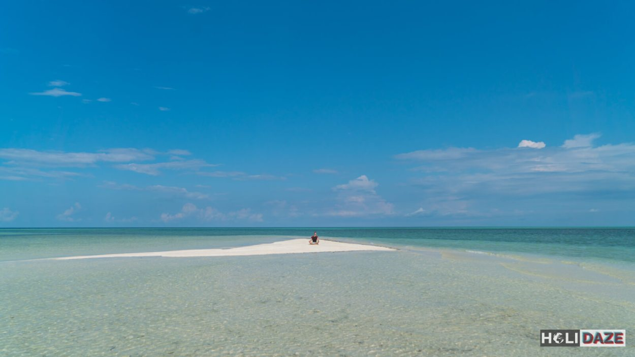 Exploring Timba Timba Island while scuba diving off the coast of Semporna, Sabah