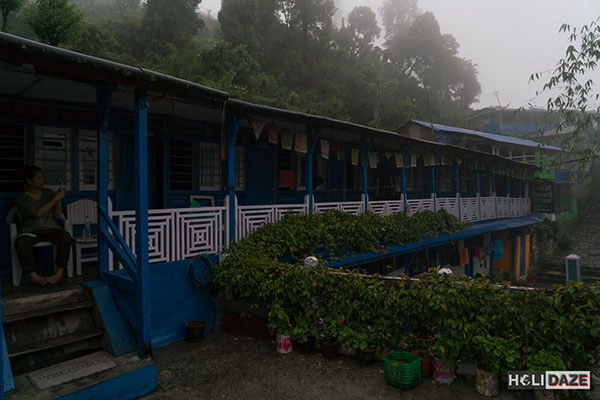 Taking shelter from the rain at a guest house while trekking Annapurna Sanctuary