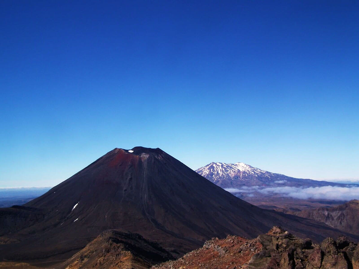 The magnificent landscape from the summit of Tongariro: Mount Ngauruhoe in the foreground and Mount Ruapehu in the background
