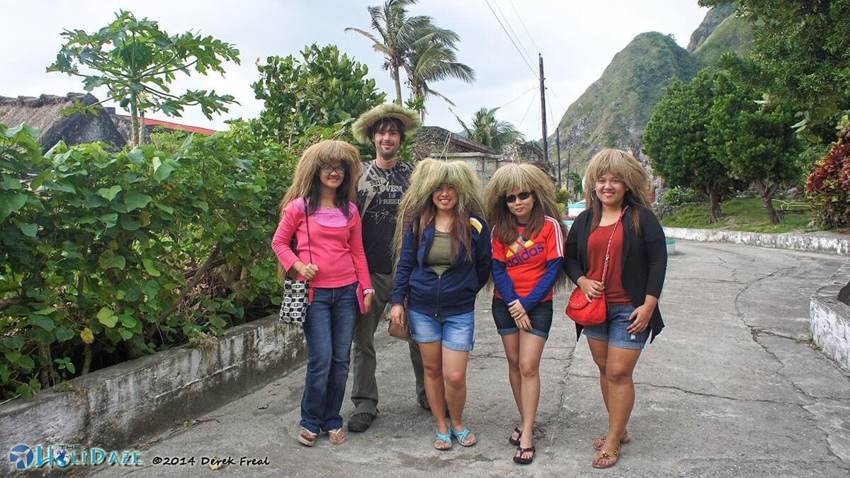 Trying on valkul headgear at Chavayan traditional village on Sabtang island, Batanes, in the northern Philippines