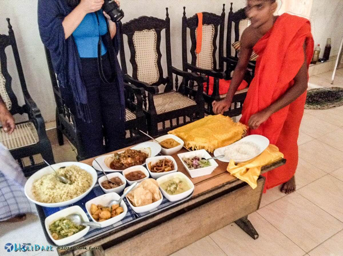 Giving the monk at Girihadu Seya his daily meal