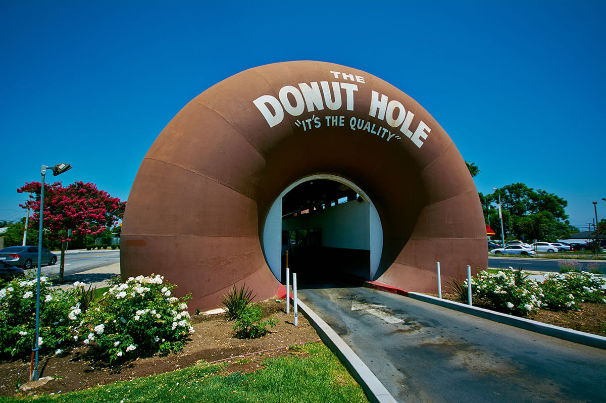 The famous, quirky and delicious Donut Hole drive-thru doughnut shop is one of the oldest offbeat Anaheim activities
