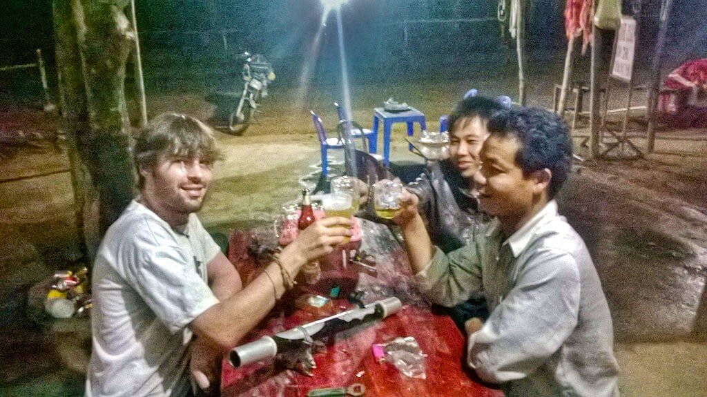 Making local friends in Vietnam over beer