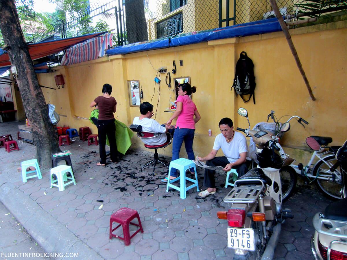 Street barber in the Old Quarter of Hanoi, Vietnam