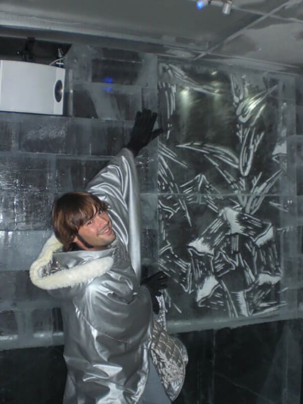 Derek Freal posting with ice sculptures at Ice Bar Tokyo in Japan