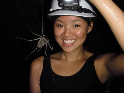 Kim holding a large spider inside of the Venado Caves near Arenal Volanco