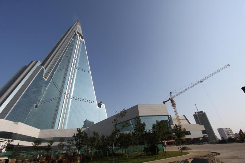 A crane sits unused out front of the Ryugyong Hotel in Pyongyang, North Korea