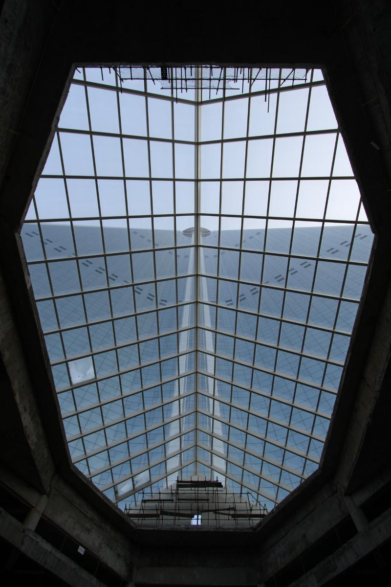 The view from inside the Ryugyong Hotel lobby entrance in Pyongyang, North Korea, looking up at the building against the sky
