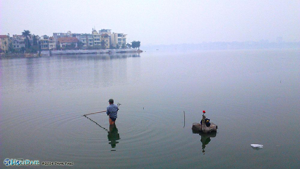 Fisherman In Hồ Tây (West Lake) in Hanoi