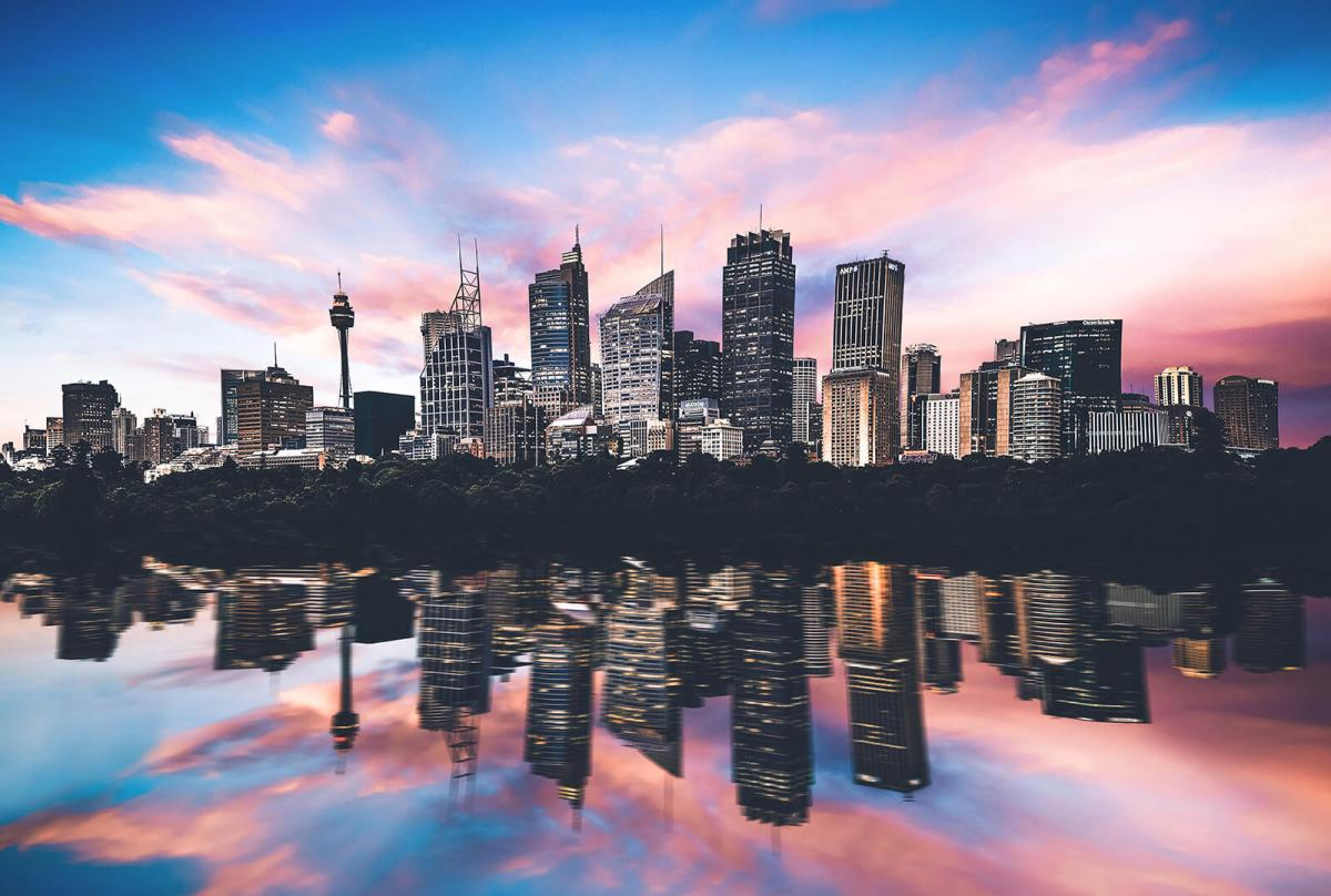 Colorful Sydney skyline and reflection across the Harbour