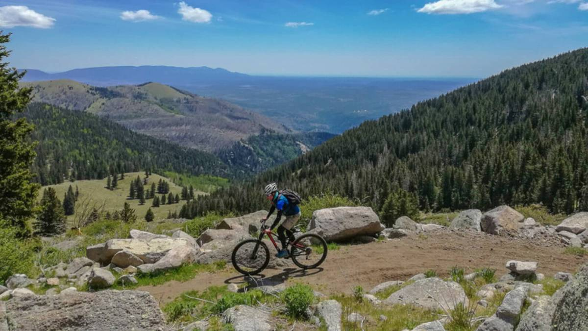Bicycling around Grindstone Lake, one of the dozen lakes in Ruidoso, New Mexico