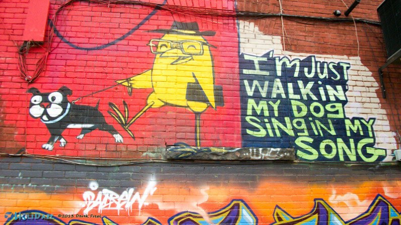 """I'm just walking my dog singing my song"" street art in Graffiti Alley, Toronto, Canada"