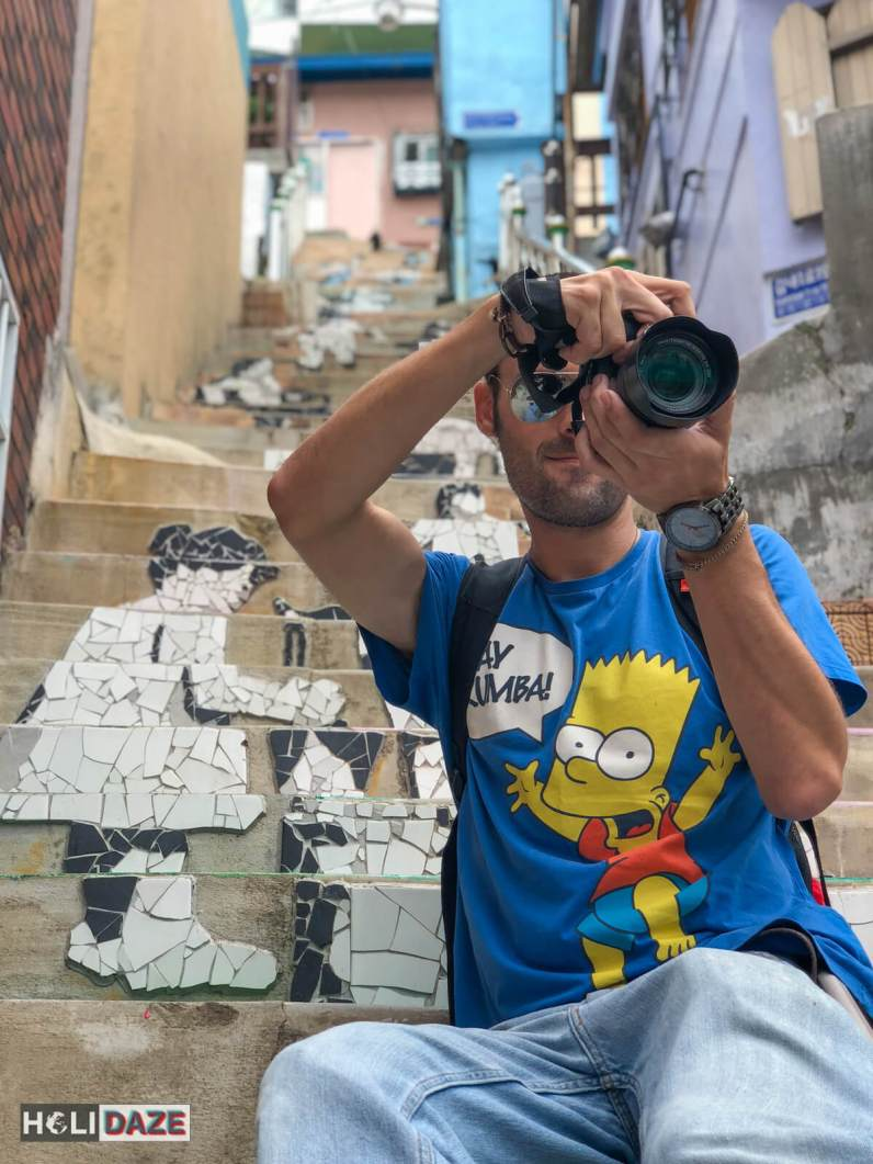 Derek Freal taking photos at the Stairs To See Stars in Gamcheon Culture Village, Busan, South Korea