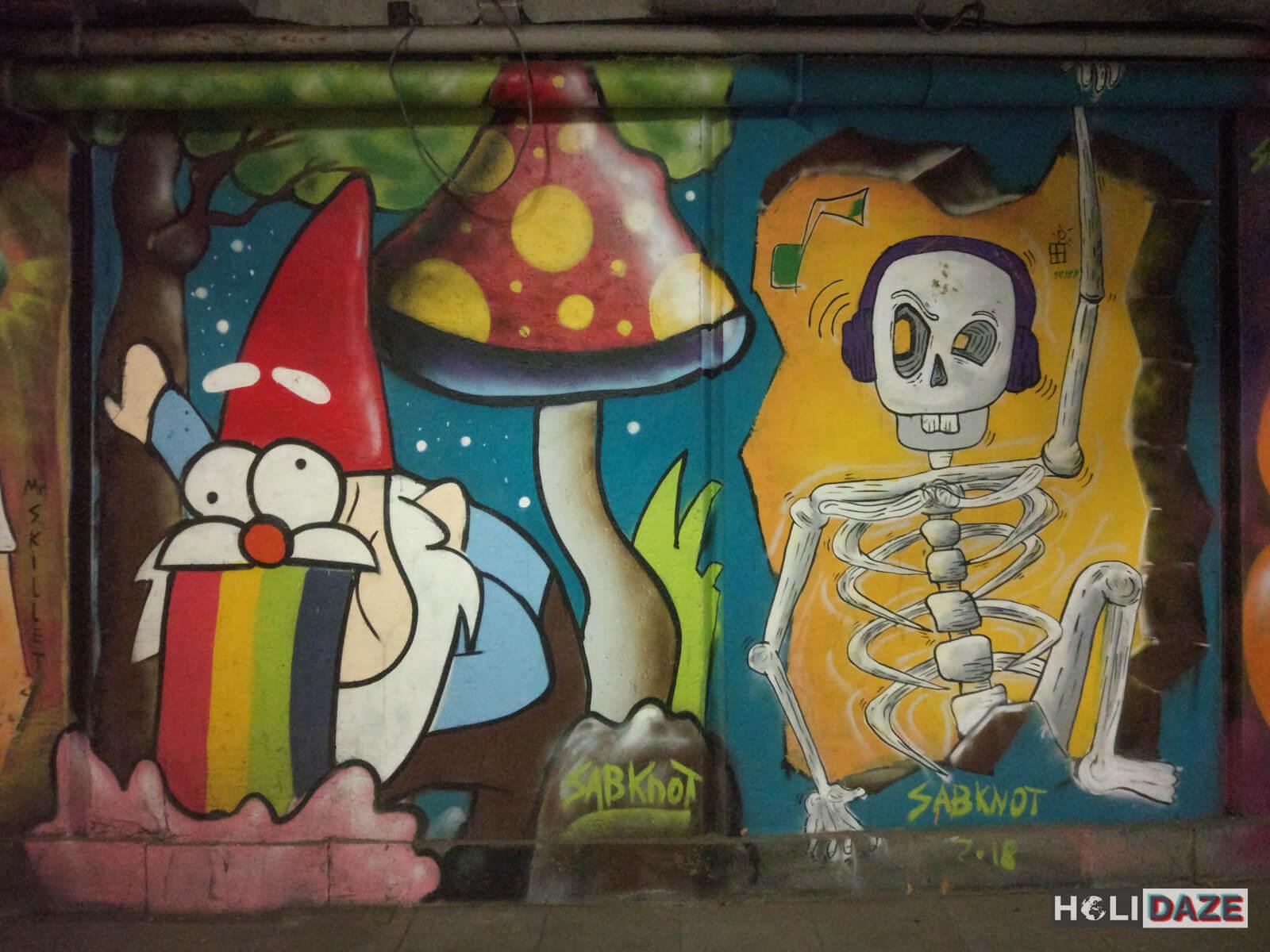 Tbilisi street art featuring elves, mushrooms and skeletons