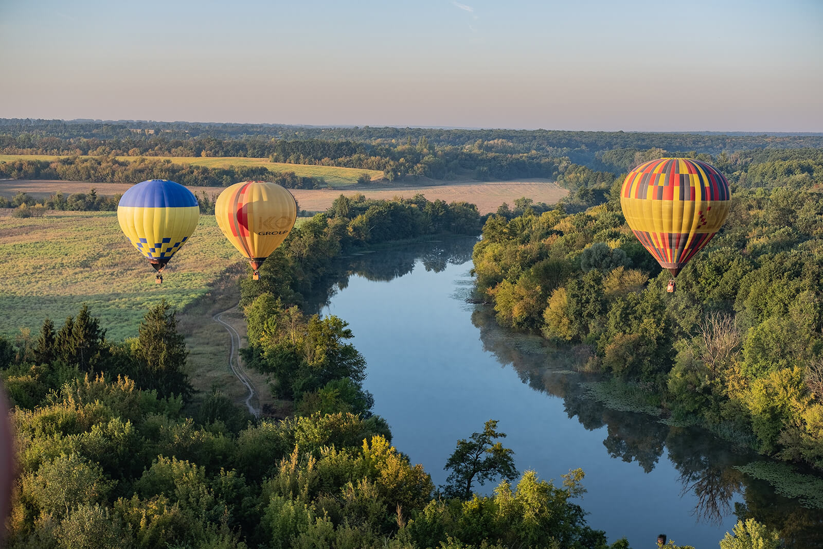 Hot air balloons over the river