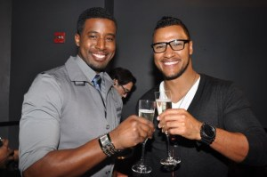 Gavin Houston & Andre Hall share a toast (left).