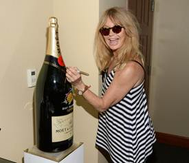 Actress Goldie Hawn visits the Moet and Chandon Suite at the 2015 BNP Paribas Open on March 21, 2015 in Indian Wells, California. (Photo by Michael Kovac/Getty Images for Moet and Chandon)