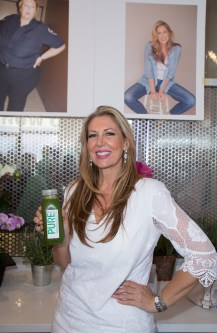 The owner of PURE Dawn Dail holding her favorite green juice