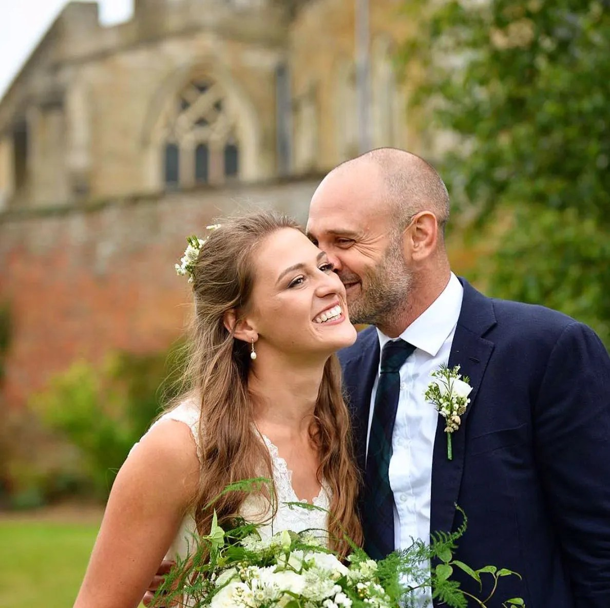 Adventurers Laura Bingham and Ed Stafford celebrating their wedding reception in the walled garden of their home in Hallaton, Leicestershire