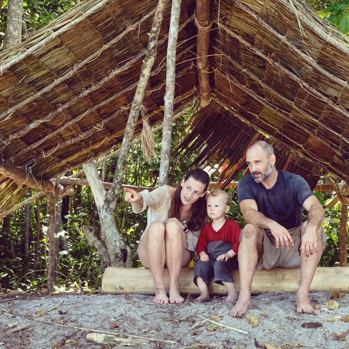 Adventurers Ed Stafford and Laura Bingham with their son Ran in their beach shelter on a remote Indonesian Island filming Man Woman Child Wild for Discovery