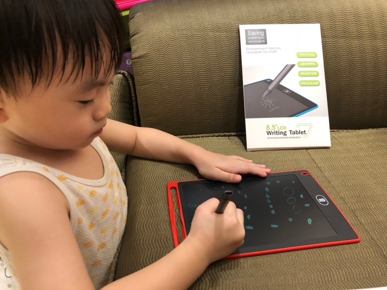 Leroy playing with writing tablet from Shopee