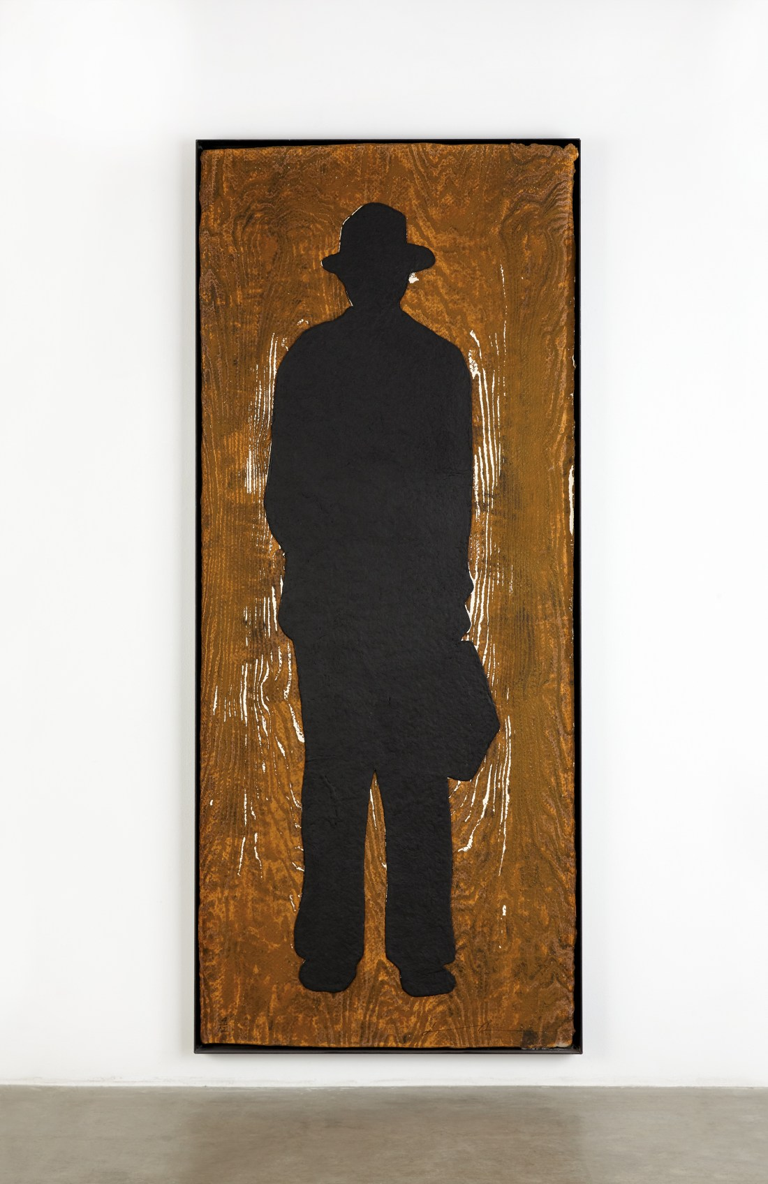 Man with a Briefcase (C), a woodcut with collage on handmade paper by Jonathan Borofsky. It's the fourth of a 1991 limited edition of 12, and it measures 92 inches by 39 inches.