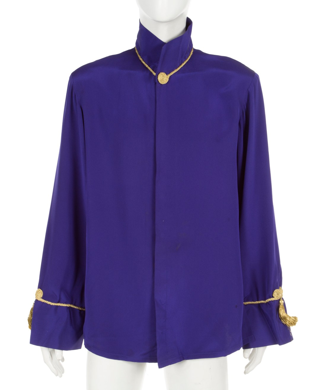 A custom-made purple tunic with gold piping and tassels, worn by Prince during a lengthy interview with Tavis Smiley on the BET channel on October 27, 1998.