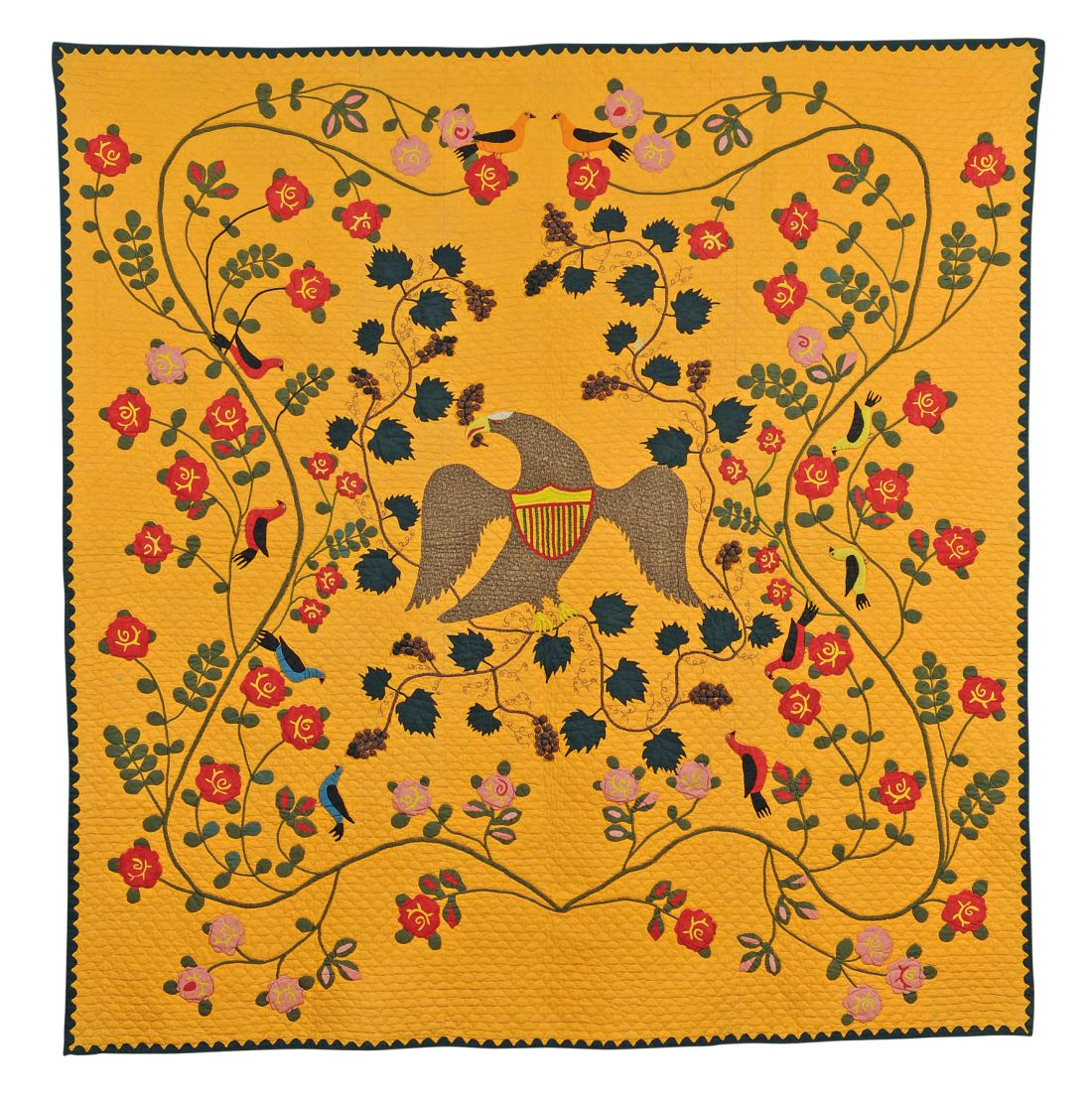 A stunning pieced and appliquéd cotton memorial quilt, created circa 1863 by Mary (aka Polly) Bell Shawvan. Its background is a warm yellow, almost a school bus yellow. At its center is a spread-winged eagle with an American shield on its chest. It is surrounded by blooming branches and vines in a winding but symmetrical pattern. Several small birds with black wings perch on the branches. Unlike most quilt-makers, Shawvan treated the quilt as a large canvas to spread her imagery upon, rather than stitching blocks together.