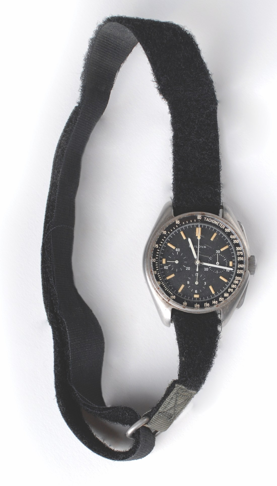 The Bulova chronograph that astronaut David Scott wore on the surface of the moon during the Apollo 15 mission, shown in full, with the fuzzy side of the velcro strap visible.