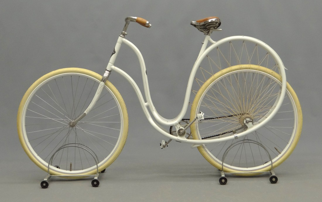 """An 1898 Cygnet """"Swan"""" Ladies pneumatic safety bicycle, shown in full profile."""