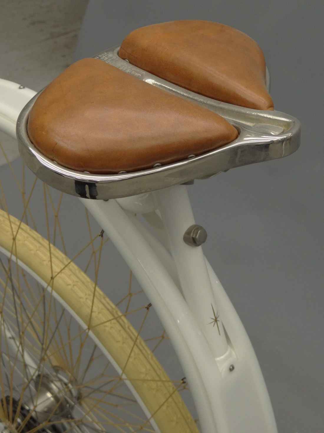"""Detail shot of the seat of the 1898 Cygnet """"Swan"""" Ladies pneumatic safety bicycle."""
