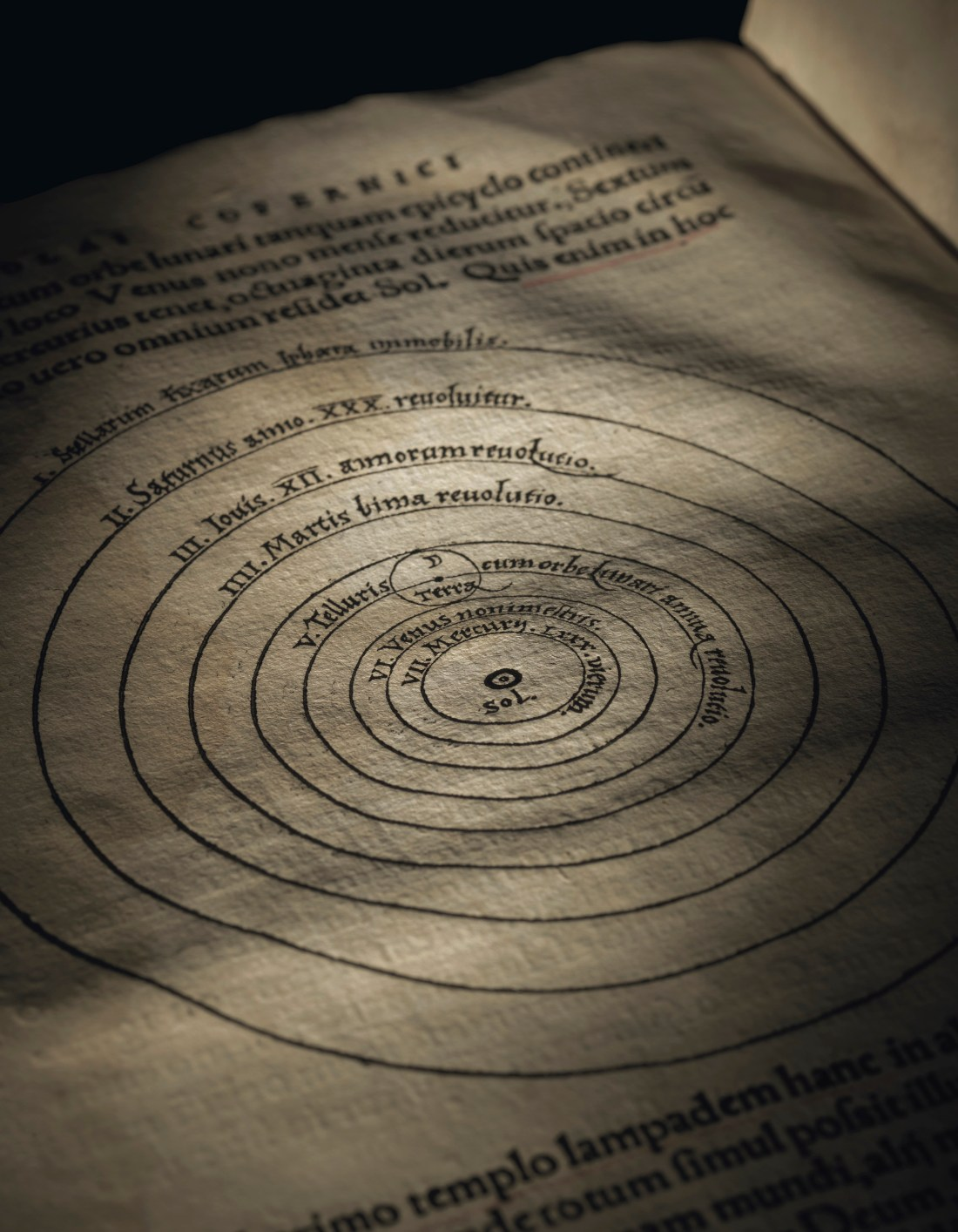 The 1543 Copernicus, open to the page showing the woodcut illustration that places the sun at the center of everything, rather than the earth.