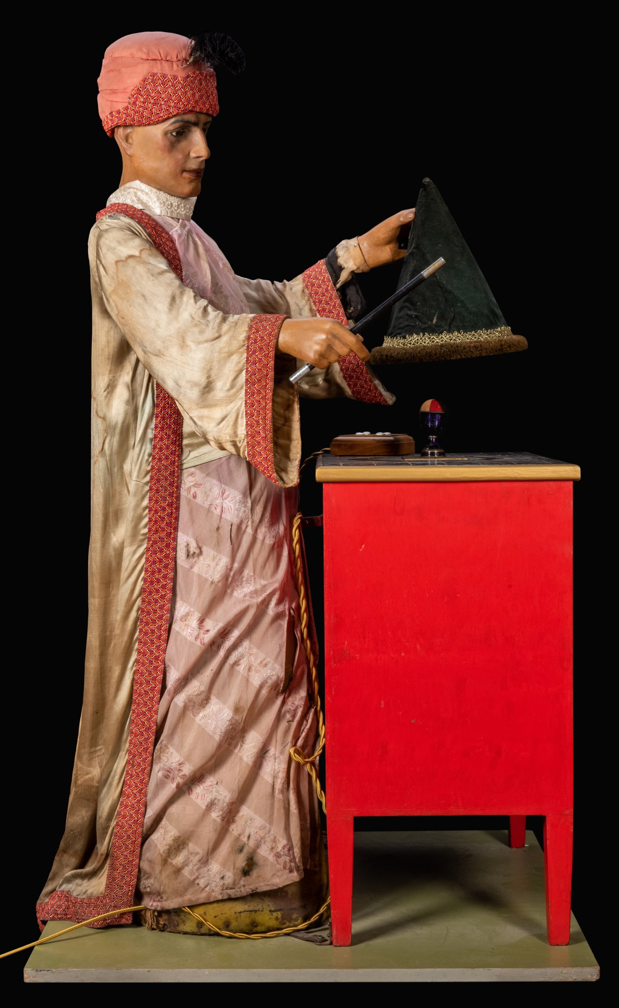 The magician automaton from Sleuth, shown in full and in profile.
