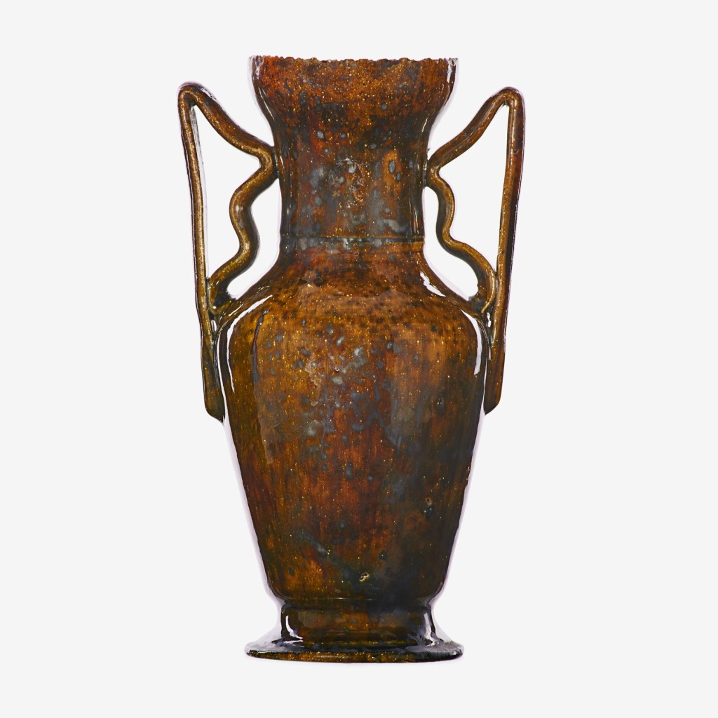 An exceptional large vase with ear handles and a serrated rim by George Ohr, dating to 1897 to 1900.