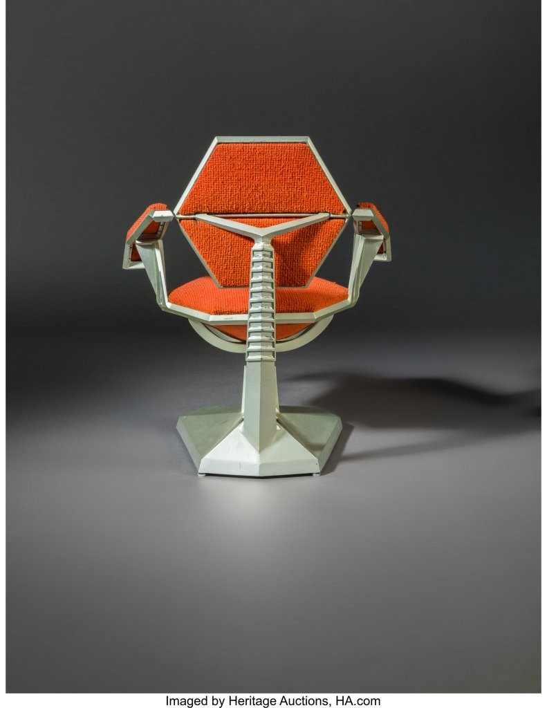 The Frank Lloyd Wright armchair for Price Tower, shown in full from the rear.