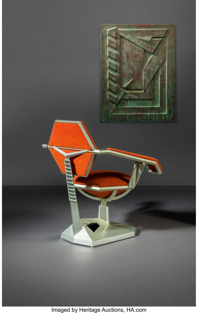 The Frank Lloyd Wright armchair for Price Tower, shown from the rear in three-quarter view.