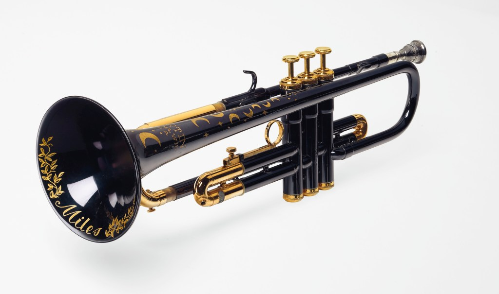 "A model T3460 ""Committee"" trumpet with a midnight blue epoxy body and gilt moon and stars decorations, commissioned by jazz legend Miles Davis in the early 1980s."